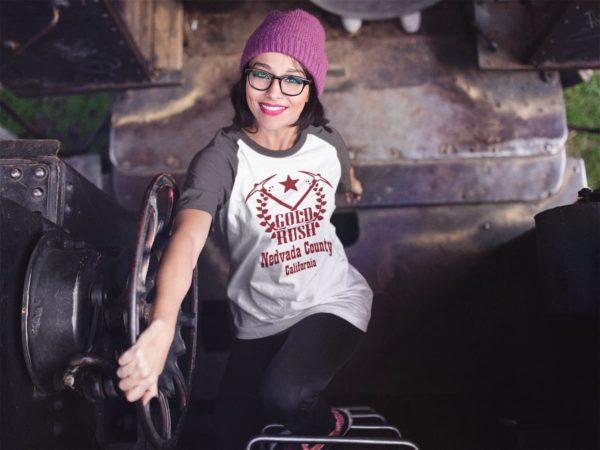 raglan-t-shirt-mockup-of-a-girl-climbing-up-a-train-ladder-Nevada County Gold Rush