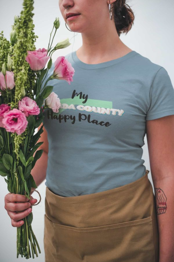 closeup-mockup-of-a-woman-wearing-a-t-shirt-while-holding-a-bouquet-of-flowers